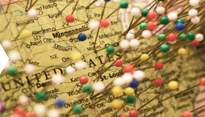 map with pins stuck in hometowns of Studio 21 customers