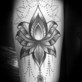 black and grey lotus tattoo
