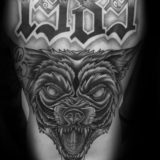 black and grey wolf tattoo