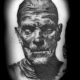 black and grey mummy portrait tattoo