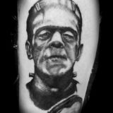black and grey frankenstein portrait tattoo