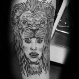 black and grey girl with lion headdress tattoo