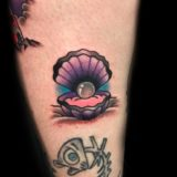 seashell pearl tattoo