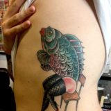 lady fish in chair tattoo