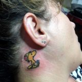 snoopy on ear tattoo