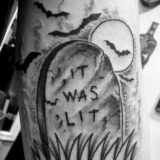 black and grey tombstone tattoo