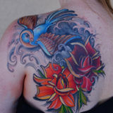 bird with 2 roses tattoo