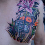 hot rod in field with flowers tattoo
