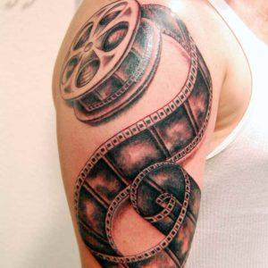 black and grey film roll tattoo