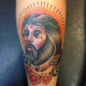 traditional jesus tattoo on forearm