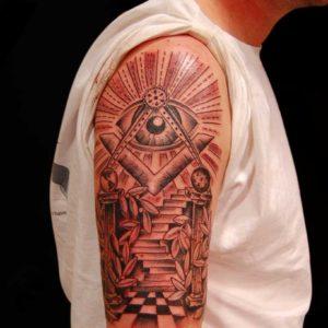 black and grey luminatta tattoo on arm