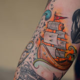 ship at sunset tattoo