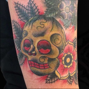 skull and flower tattoo