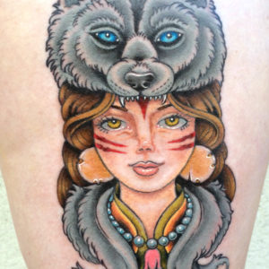 indian girl with wolf headdress tattoo