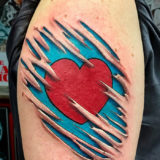 heart tear out tattoo