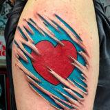 heart tear out tattoo