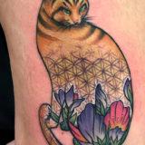 geometric floral cat tattoo