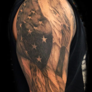 black and grey american flag tattoo