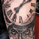 black and grey owl and pocketwatch tattoo