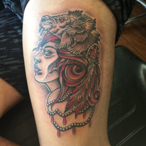 indian with wolf headdress tattoo