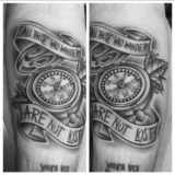 black and grey compass tattoo