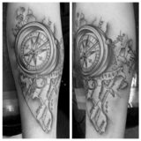 black and grey compass map tattoo