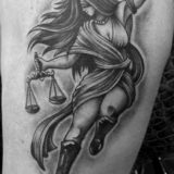black and grey scales of justice tattoo