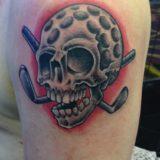 skull golf ball tattoo