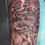 crowned skeleton tattoo