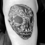 fractal black and grey skeletal mask tattoo
