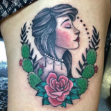 female with cactus rose tattoo