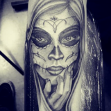 black and grey day of dead portrait tattoo