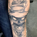 black and grey scarecrow tattoo