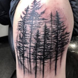 black and grey forest tattoo