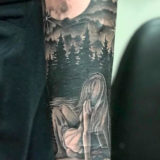 black and grey girl and mountain tattoo