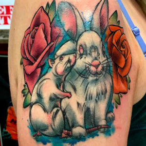 bunny and roses tattoo on arm