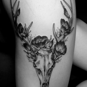 black and grey floral deer skull tattoo