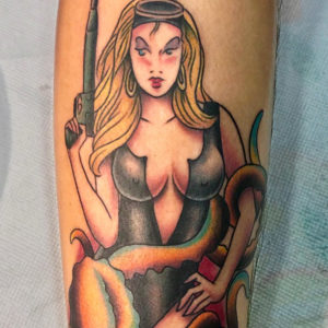 female diver tattoo on forearm