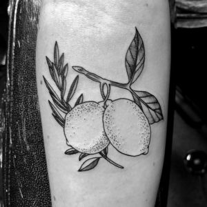 fruit black and grey tattoo on forearm