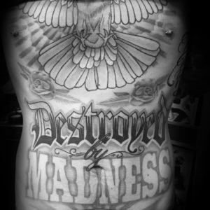 black and grey large lettering tattoo