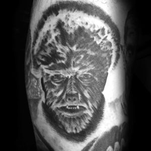 wolfman portrait tattoo in black and grey
