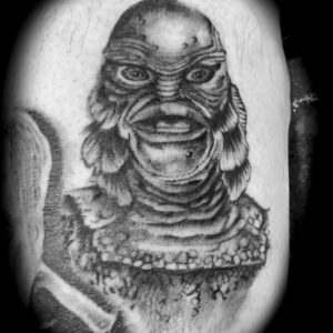 black and grey portrait tattoo of creature of the black lagoon