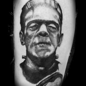 black and grey portrait tattoo of frankenstein