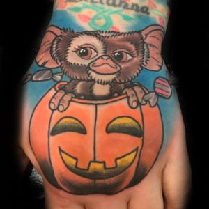 gremlins color hand tattoo