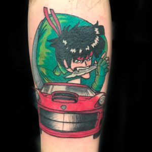 anime boy driving car tattoo