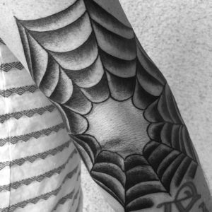traditional spider web elbow tattoo