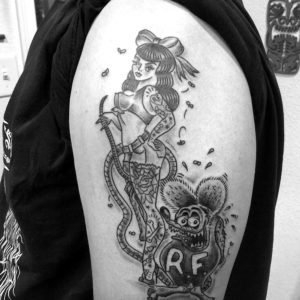 pin up with rat fink tattoo on upper arm