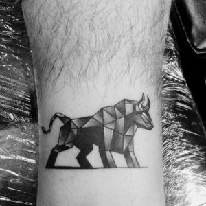 black and grey geometric bull tattoo