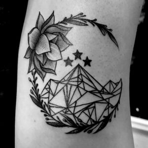 geometrical black and grey mountain tattoo