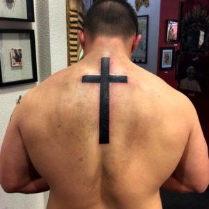religious cross tattoo on back